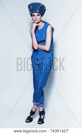 Fashionable Woman In Denim Jumpsuit And Hat