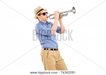 Young musician playing a trumpet isolated on white background