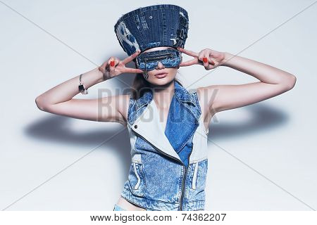 Woman In Blue Denim Hat And Waistcoat