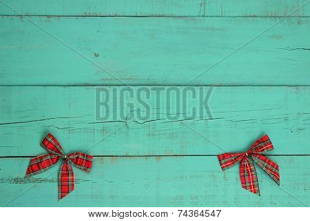 Blank antique green weathered wood background with red plaid bows border