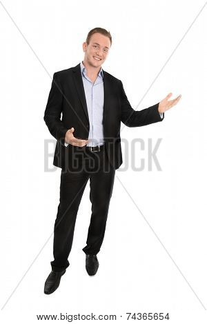 Handsome happy isolated young businessman presenting with hands over white background.
