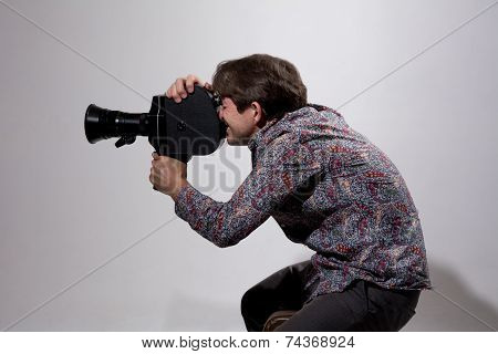 Portrait Of Cameraman With Old Movie Camera