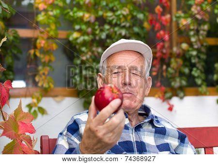Senior Man With Apple