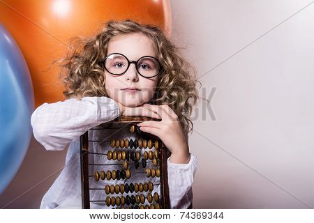 Girl Schoolgirl With Wooden Abacus.