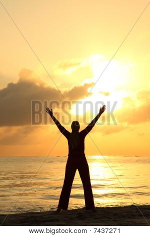 Woman's Silhouette On The Beach