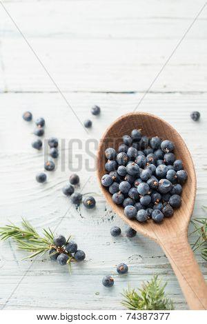 Wooden spoon with juniper berries