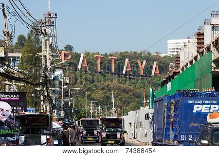 Pattaya, Thailand - January 14, 2012: The street of Pattaya with pedestrians and advertizing signs i