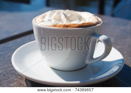 Cappuccino on the wooden table