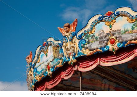 Amusement park - piece of roof of carousel richly decorated with bright ornaments