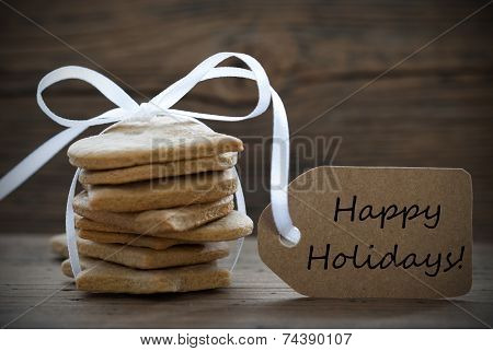 Ginger Bread Cookies With Label With Happy Holidays