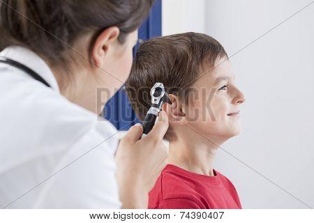 Otolaryngologist Using Otoscope