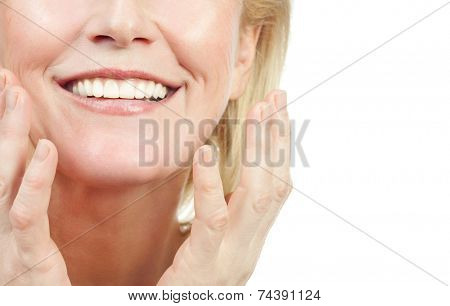 closeup portrait of attractive  caucasian smiling old mature woman brunette isolated on white studio shot lips toothy smile face hair head and shoulders looking at camera tooth riffles