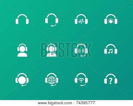 Earphones icons on green background.