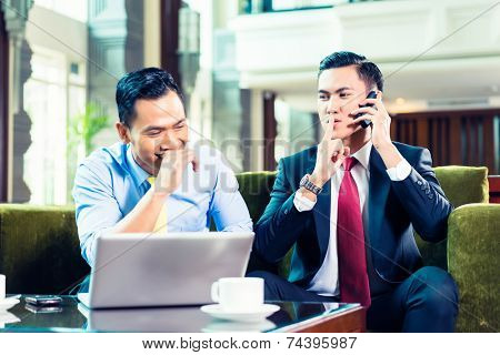 Businessman having a meeting and joking