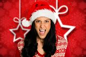 image of unnerving  - Irritated woman looking at camera against blurred christmas background - JPG