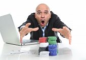 picture of spanish money  - desperate addict businessman on computer laptop winning and loosing money betting on internet poker with cards and chips on online gambling addiction isolated on white - JPG