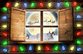 picture of roof-light  - Decorative lights hanging in a shape against santa delivery presents to village - JPG