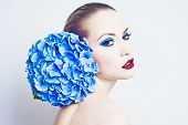 stock photo of hydrangea  - Fashion portrait of beautiful young lady with blue hydrangea - JPG