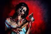 pic of ax  - Scary bloody zombie girl with an ax - JPG