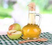 foto of cider apples  - Apple cider vinegar in glass bottle and ripe fresh apples - JPG