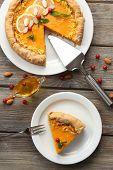 stock photo of pumpkin pie  - Homemade pumpkin pie on table - JPG