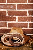 stock photo of horseshoe  - American West still life with old horseshoe - JPG