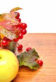 pic of pimp  - Red viburnum berries in the glass and an apple on the wooden background - JPG