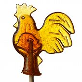 stock photo of cockerels  - A sugar lollipop in the shape of a cockerel isolated on a white background - JPG