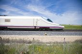 stock photo of high-speed train  - side of locomotive high speed train in a landscape from Spain  - JPG