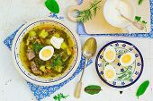 image of sorrel  - Sorrel egg and sour cream soup in a plate on a table - JPG