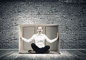 picture of trap  - Young emotional woman trapped in carton box - JPG
