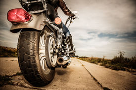 foto of biker  - Biker girl riding on a motorcycle - JPG