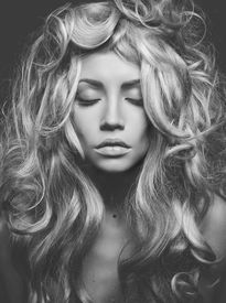 foto of perm  - Black and white portrait of beautiful woman with magnificent blond hair - JPG
