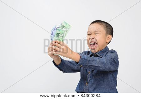 Young Boy With Happy And Smile With Korean Won Bank Note