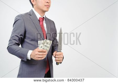 Man In Suit Holding Knife And Dollar Note