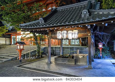 Kyoto, Japan - April 23, 2014: View of  Yasaka Shrine Main Gate's purification fountain. Yasaka Shrine, once called Gion Shrine, is a Shinto shrine in the Gion District of Kyoto Japan.