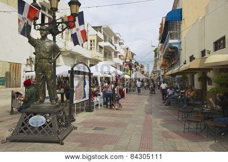 People walk at pedestrian street in Santo Domingo, Dominican Republic.