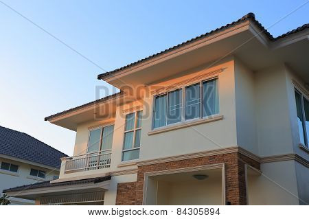 Big House Modern Style With Sunshine And Blue Sky Background