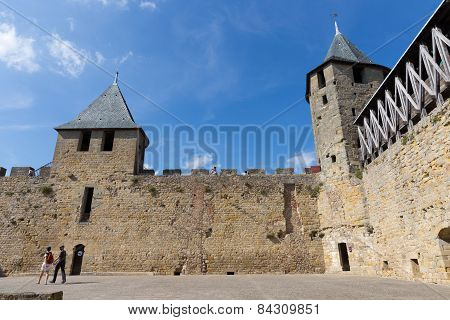 Tourists Visiting The Medieval Fortress In Carcassonne
