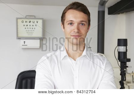 Portrait Of Male Optician In Optometrists