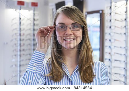 Woman Trying On New Glasses In Opticians