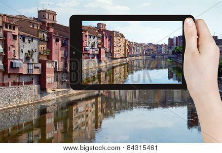 Tourist Taking Photo Of River In Girona Town
