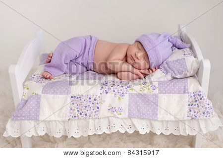 Baby Girl Sleeping On A Little Bed
