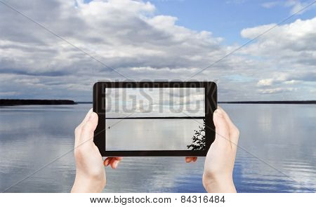 Tourist Taking Photo Of Lake Seliger, Russia