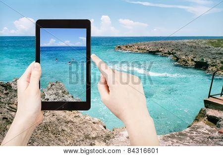 Tourist Taking Photo Of Stone Coastline Of Caribbean Sea