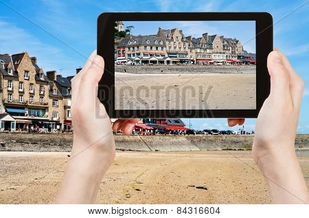 Tourist Taking Photo Of Waterfront In Cancale