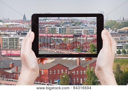 Tourist Taking Photo Of Copenhagen Skyline