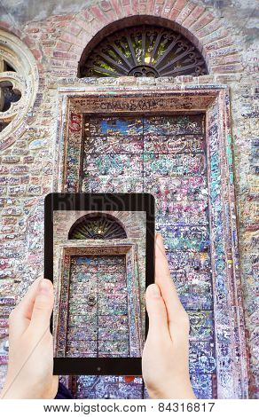 Tourist Taking Photo Of Door Of Juliet House