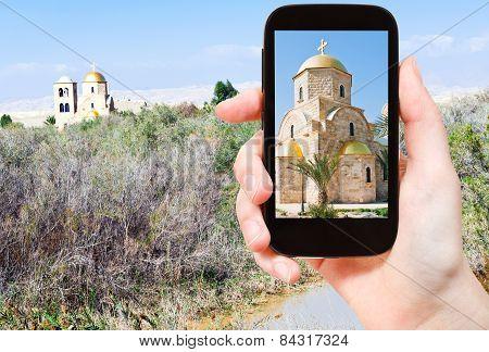Tourist Taking Photo Of Jordan River Valley