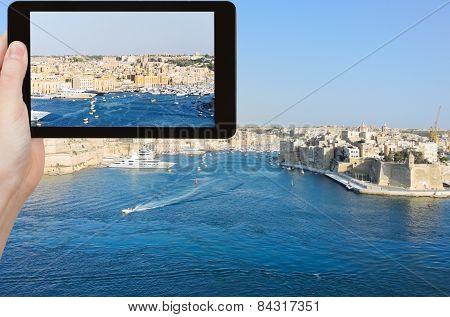 Tourist Taking Photo Of Skyline Of Valletta